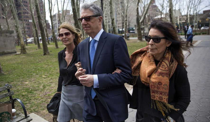 Actress Catherine Oxenberg, left, arrives at federal court with Stanley Zareff and Toni Natalie, who is Keith Raniere's ex-girlfriend, for the arraignment of NXIVM leader Raniere on Friday, April 13, 2018, in New York. Oxenberg's daughter India has been named as a co-conspirator in a criminal complaint against Raniere. (AP Photo/Kevin Hagen)