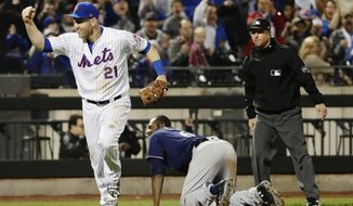New York Mets third baseman Todd Frazier (21) celebrates after tagging out Milwaukee Brewers' Lorenzo Cain (6) at third base on a throw from left fielder Yoenis Cespedes during the seventh inning of a baseball game Friday, April 13, 2018, in New York. (AP Photo/Frank Franklin II)