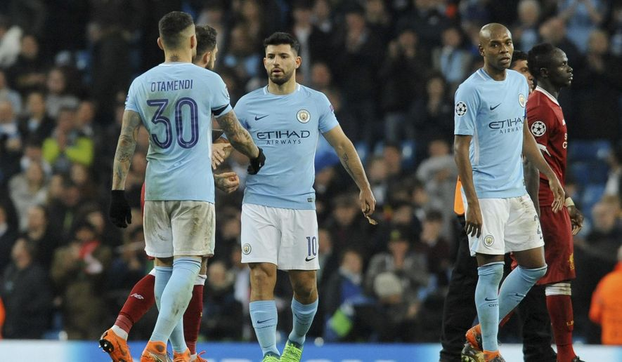 Manchester City's, from left, Nicolas Otamendi, Sergio Aguero and Fernandinho shakes hands with Liverpool players after they were defeated in the Champions League quarterfinal second leg soccer match between Manchester City and Liverpool at Etihad stadium in Manchester, England, Tuesday, April 10, 2018. (AP Photo/Rui Vieira)