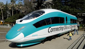 FILE - in this Feb. 26, 2015, file photo, a full-scale mockup of a high-speed train is displayed at the Capitol in Sacramento, Calif. The U.S. Department of Transportation is auditing the California high-speed rail project's federal funding. The inspector general's audit comes at the request of Republican U.S. Rep. Jeff Denham, a critic of the project. The California state auditor is already examining the project after repeated delays and cost overruns. The state is well short of the $77 billion it now estimates it needs to build a bullet train between Los Angeles and San Francisco. California has received more than $3 billion in federal money through grant programs. (AP Photo/Rich Pedroncelli, File)