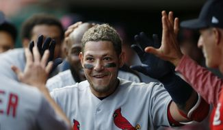 St. Louis Cardinals' Yadier Molina, center, celebrates his solo home run off Cincinnati Reds starting pitcher Tyler Mahle during the second inning of a baseball game, Friday, April 13, 2018, in Cincinnati. (AP Photo/Gary Landers)