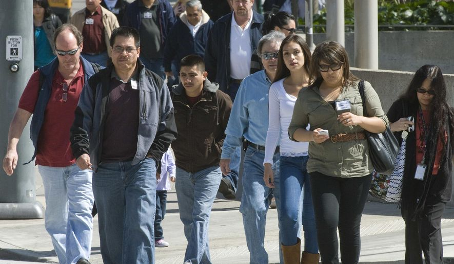 In this March 8, 2011, photo people walk down a sidewalk in Santa Ana, Calif. California Gov. Jerry Brown has created a committee to help ensure the 2020 census reflects an accurate count of the state's population, his office announced Friday, April 13, 2018. (Jebb Harris) /The Orange County Register via AP)