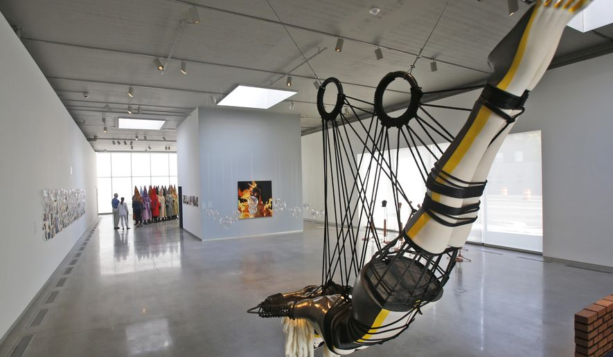 Artwork is on display in the new Markel Center which houses the Virginia Commonwealth University Institute for Contemporary Art in Richmond, Va., Friday, April 13, 2018. The Center opens April 21 with an inaugural exhibit that challenges the city's Confederate history and racial divide. (AP Photo/Steve Helber)