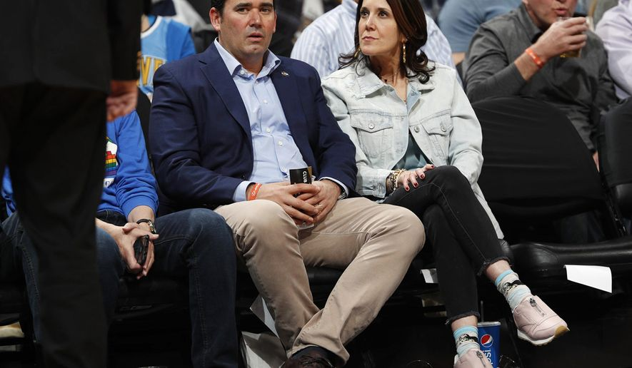 In this Thursday, April 5, 2018, photo, Colorado State Treasurer Walker Stapleton, left, sits with his wife, Jenna, in court side seats to watch the Denver Nuggets host the Minnesota Timberwolves in the first half of an NBA basketball game in Denver. Walker Stapleton will be seeking the Republican nomination to run for the state's governorship Saturday, April 14 during the Republican State Assembly in Boulder, Colo. (AP Photo/David Zalubowski)