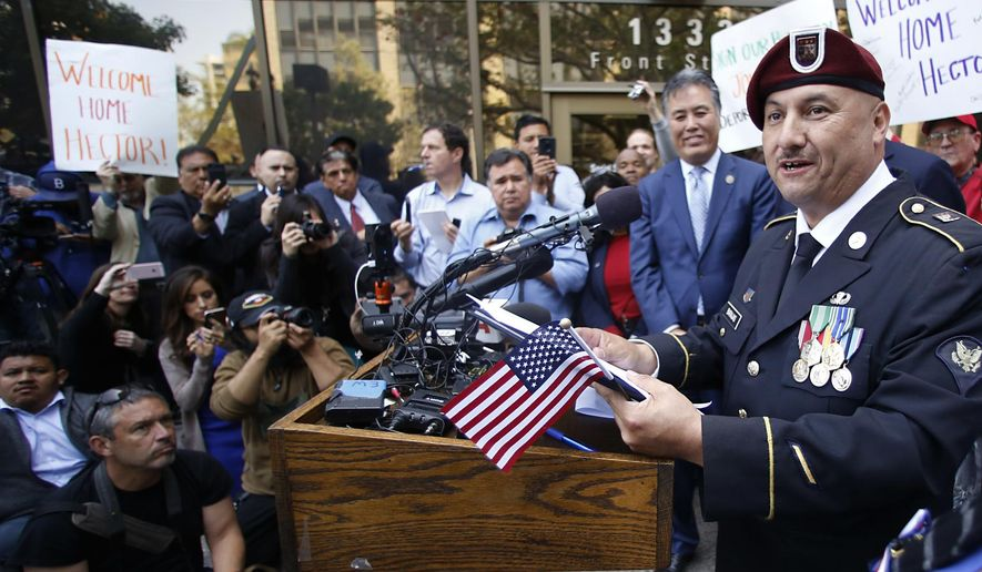 Hector Barajas speaks to the media at a news conference outside the United States Citizenship and Immigration Services office in downtown San Diego, Friday, April 13, 2018. Barajas, a decorated former U.S. Army paratrooper whose work on behalf of deported veterans drew widespread attention to his cause, became a U.S. citizen Friday, giving immigration advocates a rare reason to celebrate. (Alejandro Tamayo/The San Diego Union-Tribune via AP)