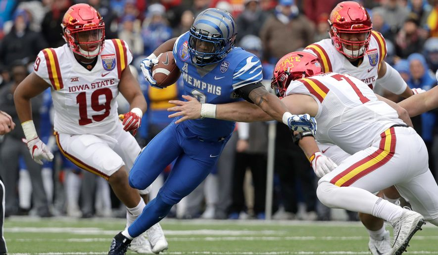 FILE -- In this Dec. 30, 2017, file photo, Memphis wide receiver Anthony Miller (3) pushes past Iowa State linebacker Joel Lanning (7) to score a touchdown in the Liberty Bowl NCAA college football game in Memphis, Tenn. Miller is trying really hard to follow the advice given to him at the NFL combine. Just slow down, just enough to stay focused and avoid making a mistake simply because the wide receiver is moving too fast. That's easier said than done for the man who had no offers from any FBS college school coming out of high school who chose to walk on at Memphis. Miller is in a hurry to prove he's the best wide receiver available in the 2018 NFL draft. (AP Photo/Mark Humphrey, File)