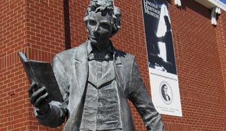 "In this March 3, 2018 photo, a statue of ""pre-beard"" Abraham Lincoln welcomes people to the  Lincoln Heritage Museum, at Lincoln College, in Lincoln, Ill. With a new director and a new exhibit that's part of Illinois' bicentennial celebration, the museum is emphasizing the importance of citizenship and responsibility. The new exhibit, ""Let Us Do Our Duty: Abraham Lincoln and Citizenship,"" opened Feb. 12 on Lincoln's birthday, and will remain open through December. (Lenore Sobota/The Pantagraph via AP)"