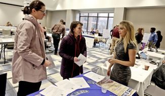 In this March 28, 2018 photo, Director of Marketing for Blue Brew Sophia Schwalbach, right,  talks with Lindsay Nolan, left, and Mandi Podeschi about the Student-Run Venture Blue Brew Coffee Shop on the campus of Millikin University in Decatur, Ill. At Millikin, performance learning is used across every discipline, drawing in students from diverse majors to work together and get real-world experience that will provide them with solid preparation for careers. (Clay Jackson/Herald & Review via AP)