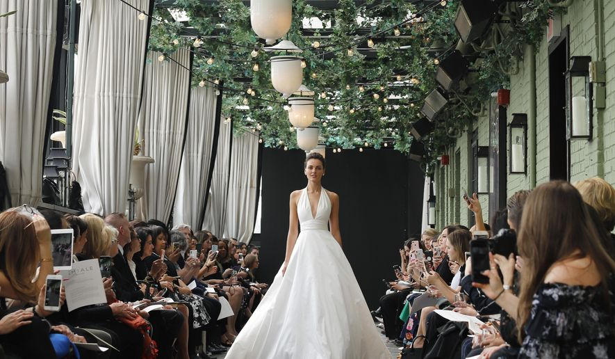 Bridal fashion from the Amsale collection is modeled during Bridal Fashion Week, Friday, April 13, 2018, in New York. (AP Photo/Bebeto Matthews)