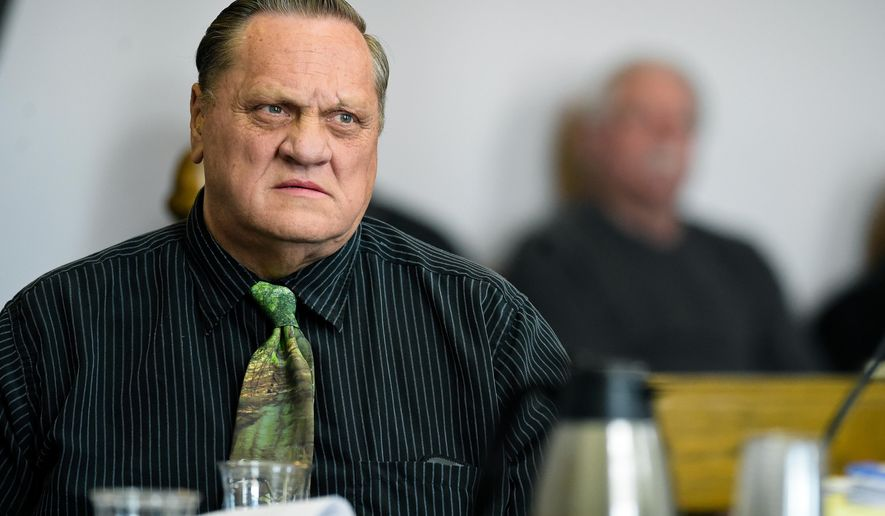 FILE - In this March 9, 2018, file photo, Paul Jenkins listens to testimony in Helena, Mont., during a hearing to review new DNA evidence related to the murder of Donna Meagher, which Jenkins was convicted of in 1995. A Montana judge has vacated the deliberate homicide conviction of Jenkins and another man in the 1995 death of the Helena woman and ordered new trials.(Thom Bridge /Independent Record via AP, File)