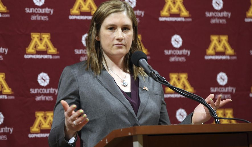 Lindsay Whalen addresses the media after she was introduced as Minnesota's new women's NCAA college basketball coach Friday, April 13, 2018, in Minneapolis. (AP Photo/Jim Mone)