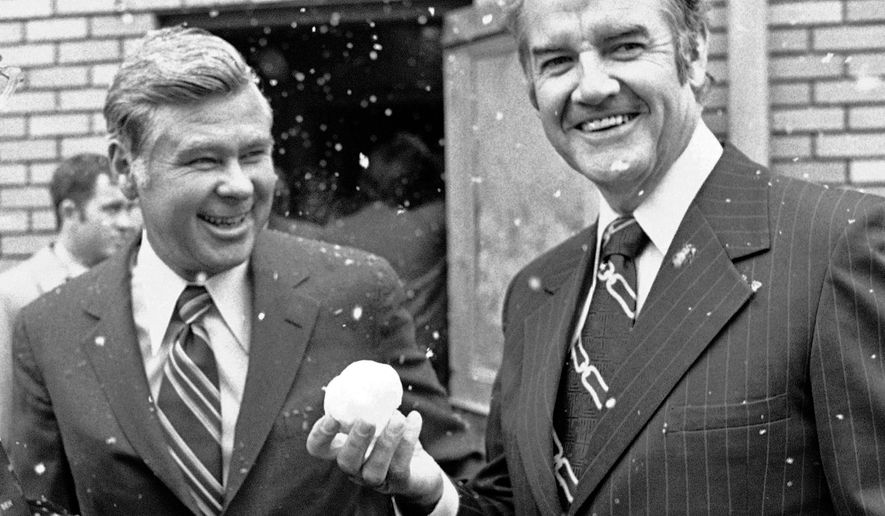 FILE--In this Sept. 25, 1972, file photo, Democratic presidential nominee George McGovern, right, holds a snowball he made, in Billings, Mont., while standing next to Montana Sen. John Melcher. Melcher, a Montana Democrat who narrowly lost a bid for a third term in 1988 just days after a wilderness bill he championed was vetoed, has died. He was 93. (AP Photo/Bob Daugherty, file)