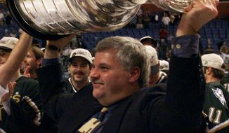 FILE - In this June 20, 1999, file photo, Dallas Stars coach Ken Hitchcock hoists the Stanley Cup after the Stars defeated the Buffalo Sabres 2-1 in triple overtime in Game 6 of the Stanley Cup finals in Buffalo, N.Y. Stars coach Ken Hitchcock is retiring, ending a 22-year career as the third-winningest coach in NHL history. Hitchcock will become a consultant for the team he led to its only Stanley Cup championship in 1999. (Ryan Remiorz/The Canadian Press via AP, File)