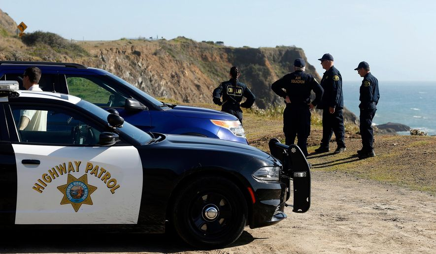 FILE - In this March 28, 2018, file photo, California Highway Patrol officers and deputy sheriffs from Mendocino and Alameda counties gather after a search for three missing children at the site where the bodies of Jennifer and Sarah Hart and three of their adopted children were recovered two days earlier, after the family's SUV plunged over a cliff at a pullout on the Pacific Coast Highway near Westport, Calif. Three of the children, Devonte Hart, 15, Hannah Hart, 16, and Sierra Hart, 12, have not been found. Authorities say a woman who drove off California cliff last month in an SUV carrying her wife and children was drunk. California Patrol Capt. Bruce Carpenter said Friday, April 13, 2018, that toxicology tests found Jennifer Hart had an alcohol level of .102. California drivers are considered drunk with a level of 0.08 or higher. Authorities don't know who was at the wheel at the time of the accident. (Alvin Jornada/The Press Democrat via AP, File)