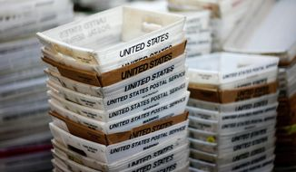 In this Dec. 14, 2017, file photo, boxes for sorted mail are stacked at the main post office in Omaha, Neb.  (AP Photo/Nati Harnik, File) **FILE**