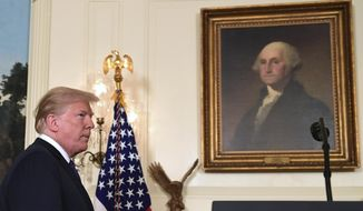 President Donald Trump arrives to speak in the Diplomatic Reception Room of the White House on Friday, April 13, 2018, in Washington, about the United States' military response to Syria's chemical weapon attack on April 7. (AP Photo/Susan Walsh)
