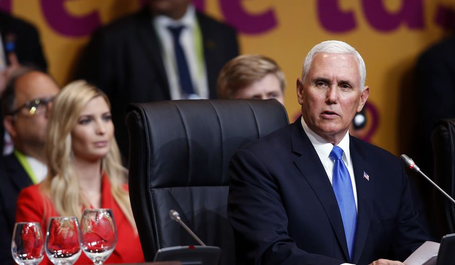 U.S. Vice President Mike Pence, right, speaks at the plenary session at the Americas Summit, as Ivanka Trump, daughter of U.S. President Donald Trump sits behind him, in Lima, Peru, Saturday, April 14, 2018. (AP Photo/Karel Navarro)