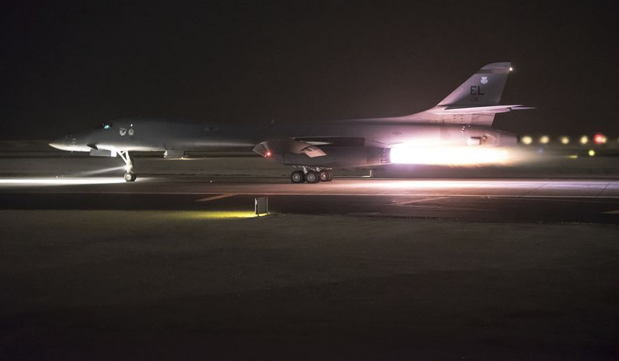 """This photo provided by the U.S. Air National Guard shows 34th Expeditionary Bomb Squadron B-1B Lancer aircraft departing from Al Udeid Air Base, Qatar, early Saturday, April 14, 2018. The U.S., Britain and France say they launched airstrikes against Syrian chemical sites after obtaining """"proof"""" that poisonous gas was used last weekend on the Damascus suburb of Douma. (Master Sgt. Phil Speck/U.S. Air National Guard via AP)"""