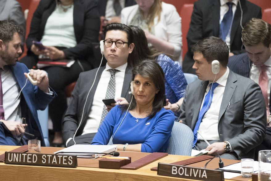 American Ambassador to the United Nations Nikki Haley listens as Syrian Ambassador to the United Nations Bashar Ja'afari speaks after a vote on a resolution during a Security Council meeting on the situation in Syria, Saturday, April 14, 2018 at United Nations headquarters. (AP Photo/Mary Altaffer)
