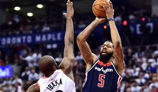 Washington Wizards forward Markieff Morris (5) shoots over Toronto Raptors forward Serge Ibaka (9) during the second half of Game 1 of an NBA basketball first-round playoff series in Toronto on Saturday, April 14, 2018. (Frank Gunn/The Canadian Press via AP)