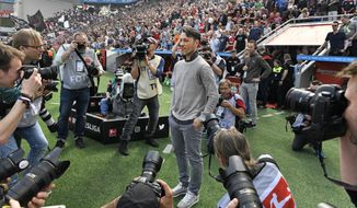 Frankfurt's head coach Niko Kovac is surrounded by cameras prior the German Bundesliga soccer match between Bayer Leverkusen and Eintracht Frankfurt in Leverkusen, Germany, Saturday, April 14, 2018. Kovac was announced as new Bayern head coach for next season. (AP Photo/Martin Meissner)