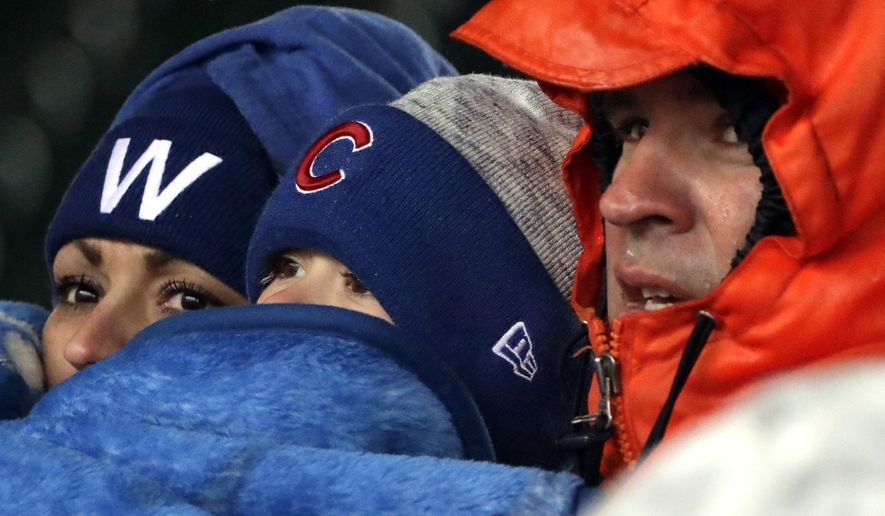 Baseball fans watch during the seventh inning of a baseball game between the Chicago Cubs and the Atlanta Braves, Saturday, April 14, 2018, in Chicago. The Cubs won 14-10. (AP Photo/Nam Y. Huh)