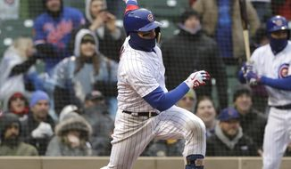Chicago Cubs' Javier Baez watches his three-run double against the Atlanta Braves during the eighth inning of a baseball game Saturday, April 14, 2018, in Chicago. (AP Photo/Nam Y. Huh)