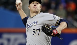 Milwaukee Brewers' Chase Anderson delivers a pitch during the first inning of the team's baseball game against the New York Mets on Saturday, April 14, 2018, in New York. (AP Photo/Frank Franklin II)