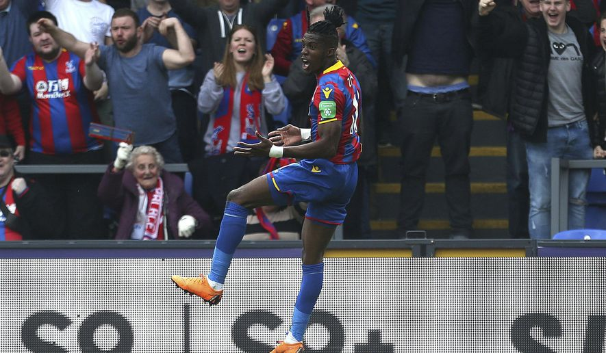 Crystal Palace's Wilfried Zaha celebrates scoring his side's third goal of the game during the English Premier League soccer match between Crystal Palace and Brighton and Hove Albion at Selhurst Park London, England. Saturday, April 14, 2018. (Steven Paston/PA via AP)