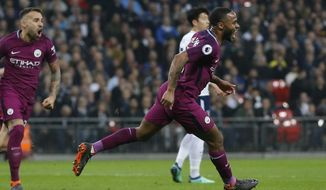 Manchester City's Raheem Sterling, right, celebrates with team mates after scoring his sides third goal during the English Premier League soccer match between Tottenham Hotspur and Manchester City at Wembley stadium in London, England, Saturday, April 14, 2018. (AP Photo/Frank Augstein)