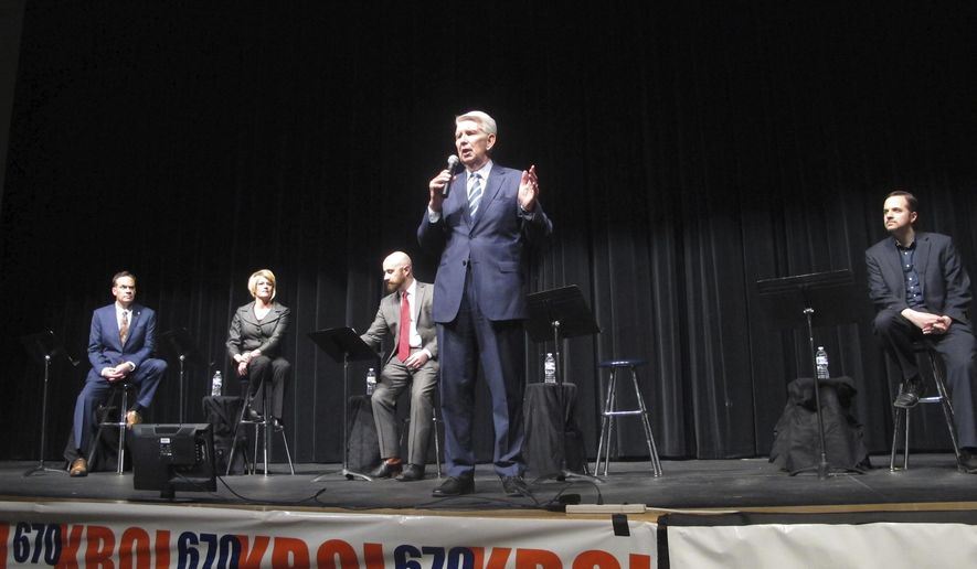 Dave Leroy, former attorney general and former lieutenant governor, at microphone, gives his opening remarks during the first televised GOP debate for Idaho's open 1st Congressional District seat in Meridian, Idaho, Saturday, April 14, 2018. Leroy debated against four other Republican opponents. (AP Photo/Kimberlee Kruesi)