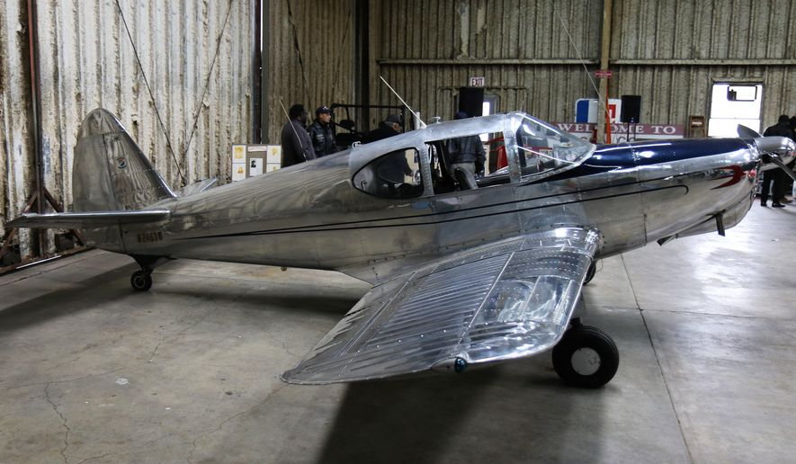 In an April 7, 2018 photo, Eugene May, of Jackson, Tennessee, earned his private pilot's license in 1948 and purchased his own 1951 Chrome Swift Global Aircraft in 1963.  May was made an honorary member of the Memphis Blackhawks Aviation Association after they learned of his flying accomplishments.  (Brittney Jackson/The Jackson Sun via AP)