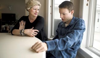 In this Wednesday, April 4, 2018 photo, Derek Seymour, 20, right, talks with his mother Kelly in Four Corners, Mont. Derek says he helped his father make the bench he's sitting on in their home.  Montana State University is launching a program offering new opportunity and hope to students with disabilities, like Derek, with a chance to go to college and learn job skills. (Freddy Monares/Bozeman Daily Chronicle via AP)