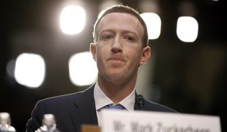 Facebook CEO Mark Zuckerberg testifies before a joint hearing of the Commerce and Judiciary Committees on Capitol Hill in Washington, Tuesday, April 10, 2018, about the use of Facebook data to target American voters in the 2016 election. (AP Photo/Alex Brandon) ** FILE **