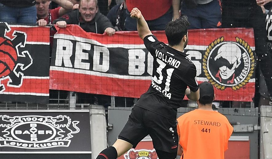 Leverkusen's Kevin Volland celebrates in front of supporters after scoring his side's second goal during the German Bundesliga soccer match between Bayer Leverkusen and Eintracht Frankfurt in Leverkusen, Germany, Saturday, April 14, 2018. (AP Photo/Martin Meissner)