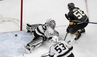 Vegas Golden Knights left wing Erik Haula (56) scores the game winning goal against Los Angeles Kings goaltender Jonathan Quick during the second overtime of Game 2 of an NHL hockey first-round playoff series, Friday, April 13, 2018, in Las Vegas. (AP Photo/John Locher)