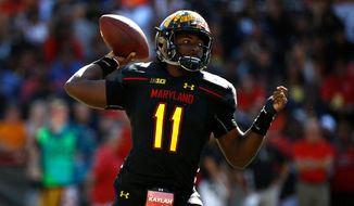 File-This Sept. 23, 2017, file photo shows Maryland quarterback Kasim Hill throwing to a receiver in the first half of an NCAA college football game against Central Florida in College Park, Md.  A new Maryland football season began exactly as the last one ended, with third-string quarterback Max Bortenschlager guiding the offense Saturday in the spring game. Tyrrell Pigrome and Hill, dressed in pads and yellow jerseys, watched from the sideline as Bortenschlager and freshman Tyler DeSue took turns implementing the pro-style scheme of first-year offensive coordinator Matt Canada.(AP Photo/Patrick Semansky, File)