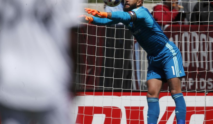 6c1cb224dd1 Colorado Rapids goalkeeper Tim Howard deflects a shot while facing Toronto  FC in the first half