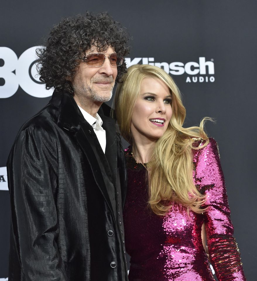 Howard Stern and his wife, Beth, arrive at the red carpet before the Rock and Roll Hall of Fame induction ceremony, Saturday, April 14, 2018, in Cleveland. (AP Photo/David Richard)  ** FILE **