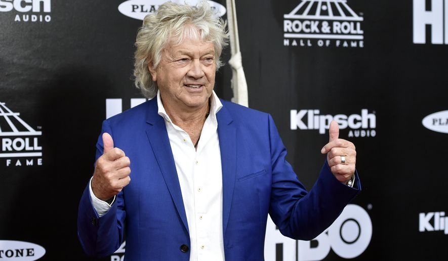 John Lodge, bassist for the Moody Blues, arrives on the red carpet before the Rock and Roll Hall of Fame Induction ceremony, Saturday, April 14, 2018, in Cleveland. (AP Photo/David Richard)