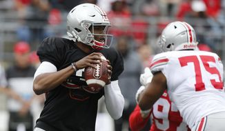 Ohio State quarterback Dwayne Haskins drops back to pass during their NCAA college spring football game Saturday, April 14, 2018, in Columbus, Ohio. (AP Photo/Jay LaPrete)