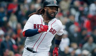 Boston Red Sox's Hanley Ramirez runs on his two-run double during the fourth inning of a baseball game against the Baltimore Orioles in Boston, Saturday, April 14, 2018. (AP Photo/Michael Dwyer)