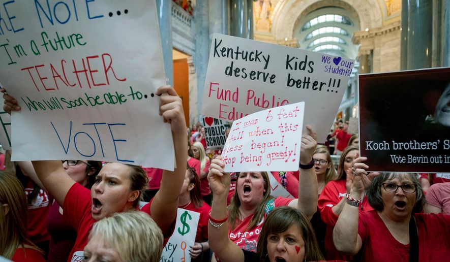 Teachers from across Kentucky gather inside the state Capitol to rally for increased funding for education, Friday, April 13, 2018, in Frankfort, Ky. The unrest comes amid teacher protests in Oklahoma and Arizona over low funding and teacher pay. The demonstrations were inspired by West Virginia teachers, whose nine-day walkout after many years without raises led to a 5 percent pay hike. (AP Photo/Bryan Woolston)