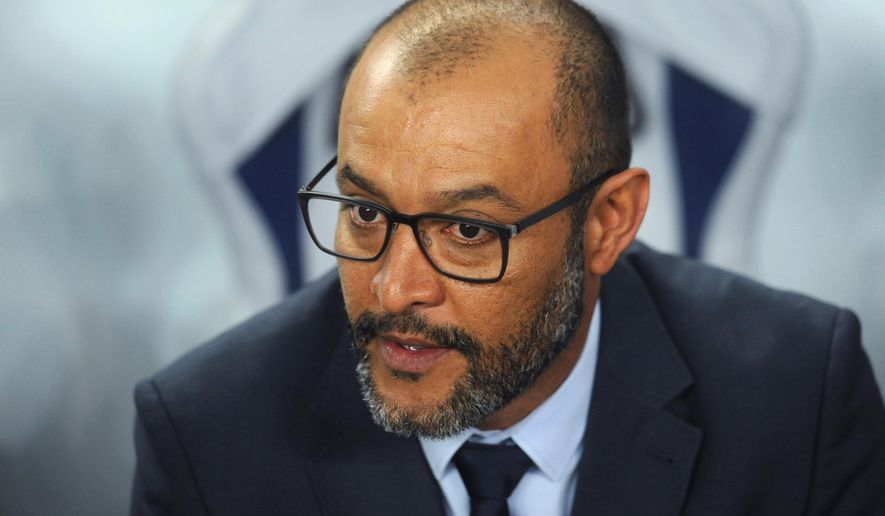 FILE - In this Nov 2 2017 file picture Former Porto's coach Nuno Espirito Santo waits for the start of a Champions League group G soccer match between FC Porto and Club Brugge at the Dragao stadium in Porto, Portugal, Wednesday, Nov. 2, 2016. (AP Photo/Paulo Duarte, File)