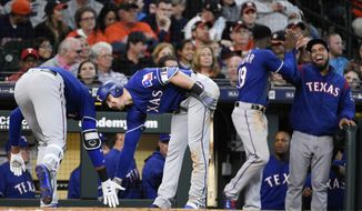 Texas Rangers' Ronald Guzman, left, celebrates his game-tying home run off Houston Astros relief pitcher Brad Peacock with Ryan Rua during the eighth inning of a baseball game Saturday, April 14, 2018, in Houston. (AP Photo/Eric Christian Smith)