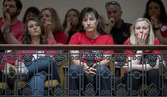 Teachers look on as The Senate votes on bills for increased funding and to changes to their state funded pension system, Friday, April 13, 2018, in Frankfort, Ky. (AP Photo/Bryan Woolston)