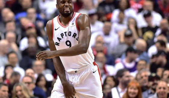 Toronto Raptors forward Serge Ibaka reacts during the second half of Game 1 of the team's NBA basketball first-round playoff series against the Washington Wizards in Toronto on Saturday, April 14, 2018. (Frank Gunn/The Canadian Press via AP)