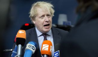 British Foreign Secretary Boris Johnson speaks with the media as he arrives for a meeting of EU foreign ministers at the Europa building in Brussels on Monday, March 19, 2018. European Union foreign ministers on Monday are set to discuss Ukraine, Syria, Korea and Iran. (AP Photo/Virginia Mayo)
