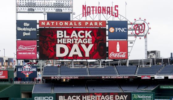 A sign for Black Heritage Day is displayed before a baseball game between the Washington Nationals and the Colorado Rockies at Nationals Park Sunday, April 15, 2018, in Washington. (AP Photo/Andrew Harnik)