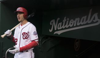 Washington Nationals' Trea Turner stands in the dugout during a baseball game against the Colorado Rockies at Nationals Park Sunday, April 15, 2018, in Washington. (AP Photo/Andrew Harnik) **FILE**